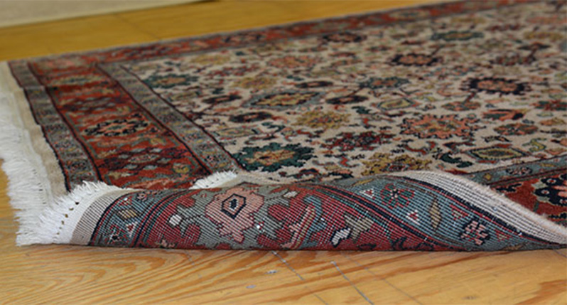 Sample of an area rug cleaned - The Carpet Doctor Inc.